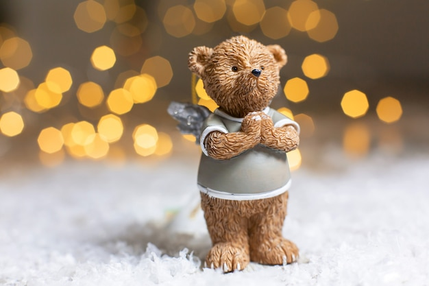 Decorative figurine of a christmas theme of a cute bear with angel wings.