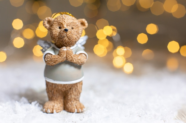 Decorative figurines of a christmas theme. figurine of a cute bear with angel wings