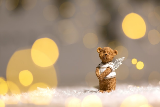 Decorative figurines of a christmas theme. figurine of a cute bear with angel wings.