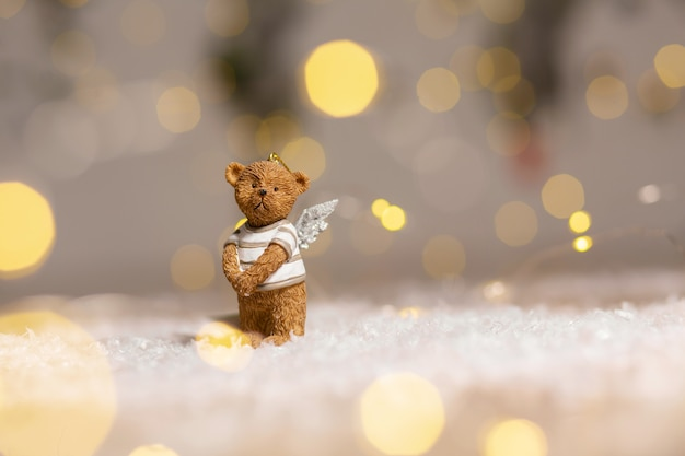 Decorative figurines of a christmas theme, figurine of a cute bear with angel wings,