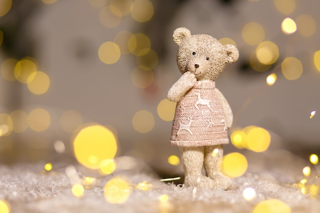 Decorative figurines of a christmas theme, figurine of a cute teddy bear girl in a sweater with deers, ,