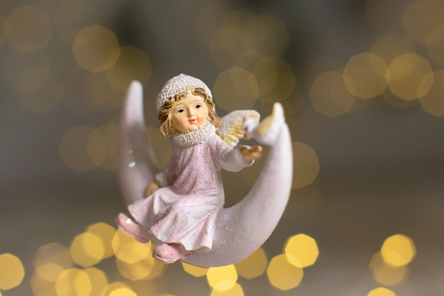 Decorative figurines of a christmas theme, statuette of an angel on a crescent moon, christmas tree decoration, ,
