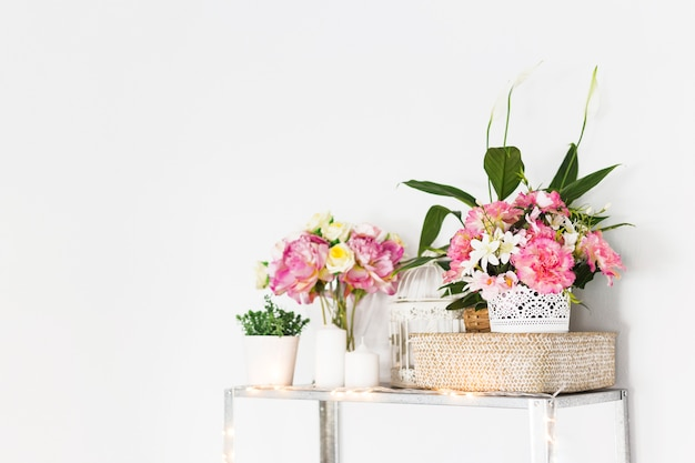Decorative flowers on cabinet in front of wall