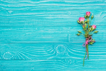 Decorative flowers on blue wooden surface