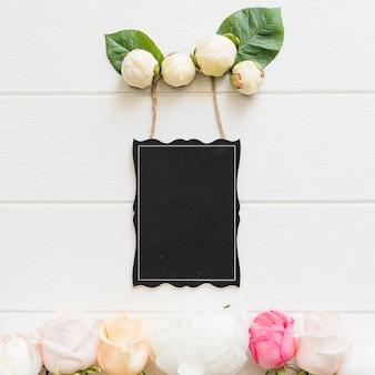 Decorative flowers with a blackboard