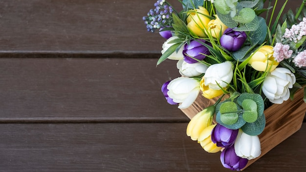 Decorative flowers in a wooden box. top view, copy space