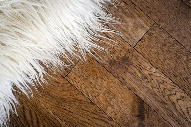 Decorative fur carpet on wood floor