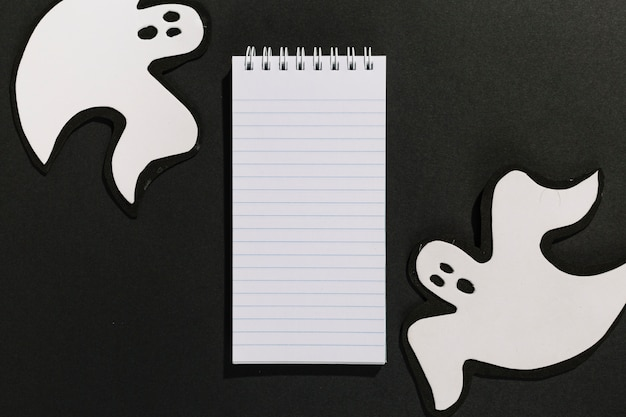 Decorative ghosts made of paper with notebook