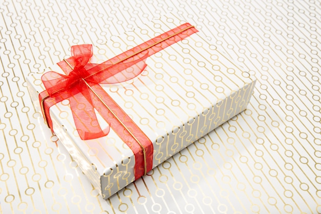 Decorative gift box with red bow and long ribbon. present concept
