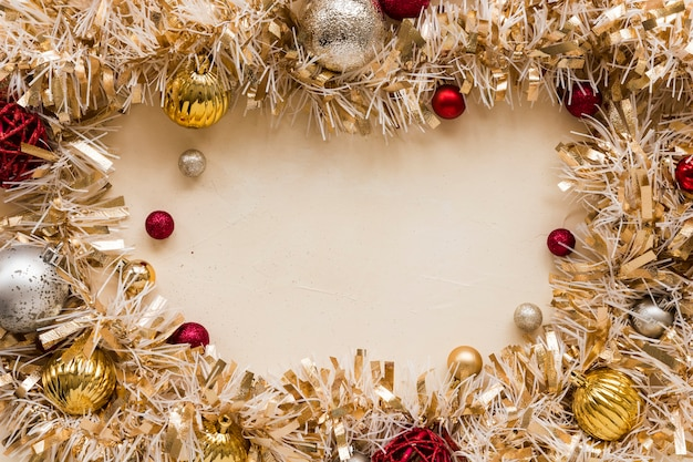 Decorative gold tinsel with ornament balls