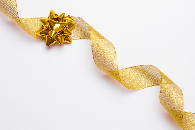 Decorative golden bow and ribbon