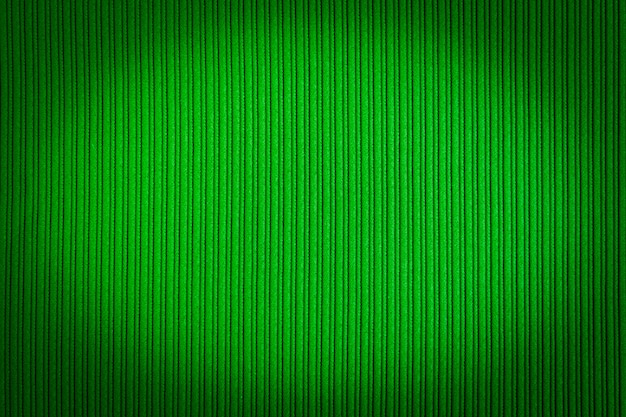 Decorative green color, striped texture, vignetting gradient.