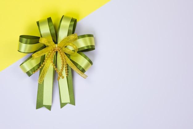 Decorative green ribbon bow on sweet pastel