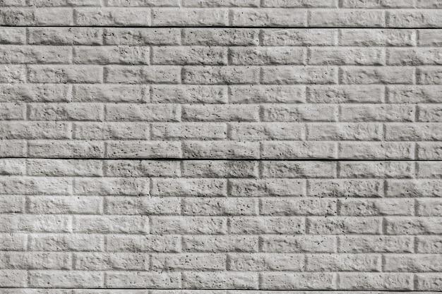 装飾的な灰色のタイルのレンガの壁のテクスチャ