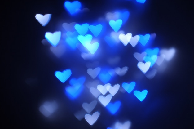 Decorative heart background, romantic love bokeh background in blue for valentine's day
