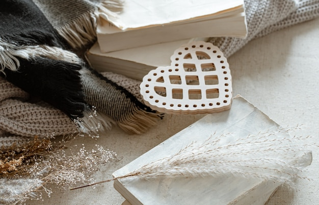 Decorative heart, knitted items and books. the concept of valentine's day and home comfort.