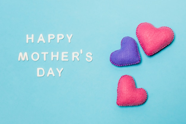 Decorative hearts near happy mothers day title