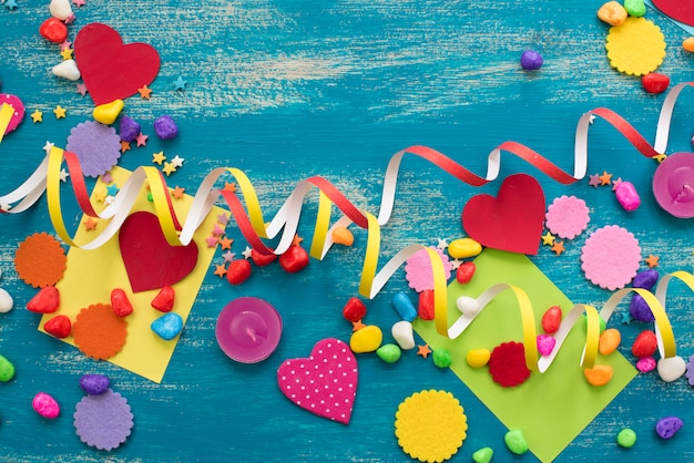 Decorative holiday background with streamers confetti candy hearts decor.