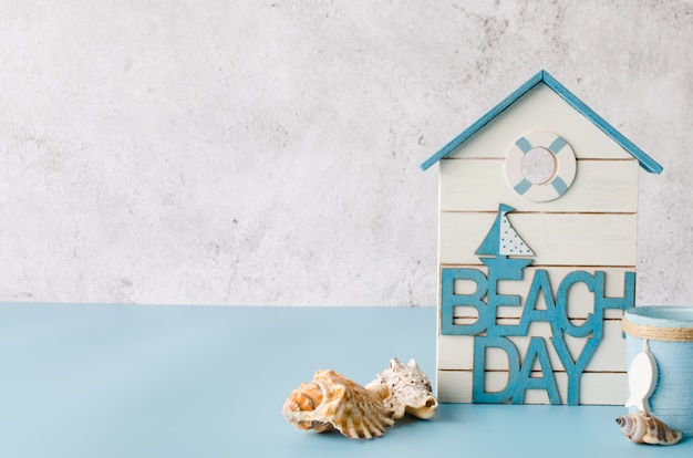 Decorative inscription beach day and seashells.