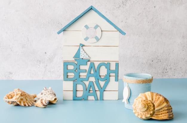 Decorative inscription beach day and seashells