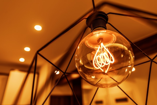 Decorative interior lighting. elegant illuminated bulb in the room.