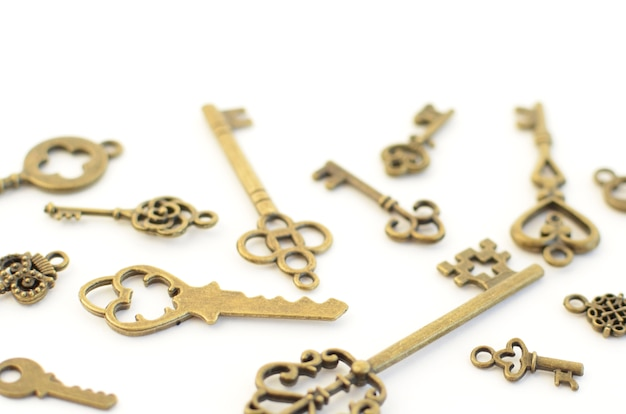 Decorative keys of different sizes, stylized antique on a white background. form the centerpiece.