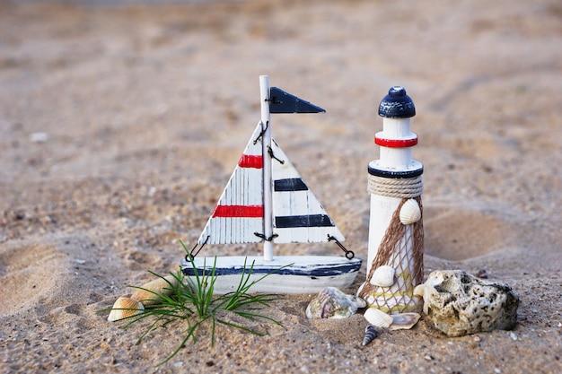 Decorative of lighthouse, sails on the beach