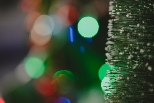 Decorative lights balls and pine christmas and newyear holiday background