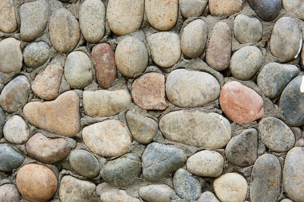 Decorative modern stone wall of chipped stone for background