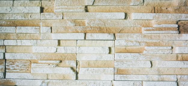 장식 천연 벽돌 벽 배경입니다. 벽에 베이지색 질감입니다. 인테리어 디자인 아이디어.