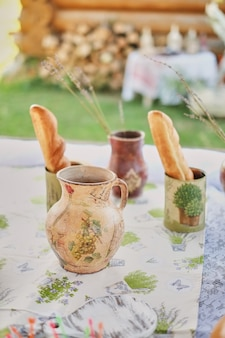 Decorative open party with small bottles and a homemade jug