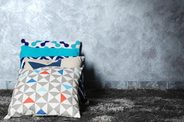 Decorative pillows on grey surface