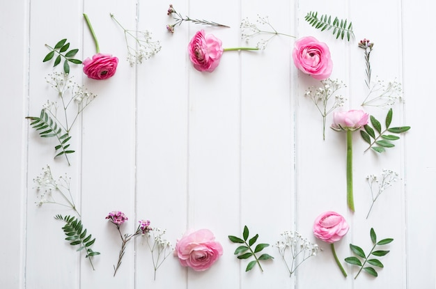 Decorative pink flowers in wooden surface
