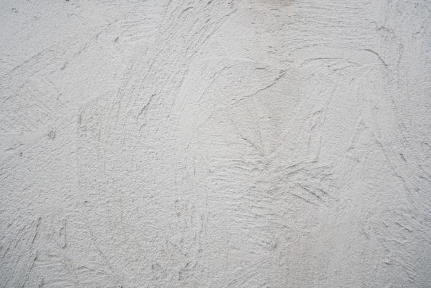 装飾的なしっくい。灰色の壁のテクスチャの背景。コンクリートスタイル。屋内での修復。メンテナンス作業。自宅でのリフォーム。