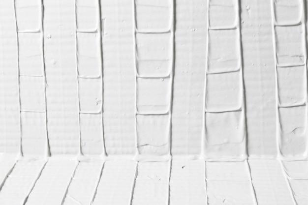 장식 석고 질감, 여유 공간이 흰색 구호 배경. 추상 패턴으로 치장 용 벽 토 표면입니다. 수리, 디자인 컨셉