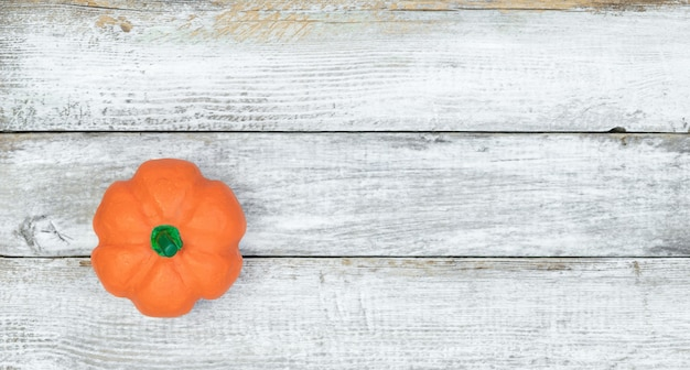 Decorative pumpkin on a white wooden surface  top view