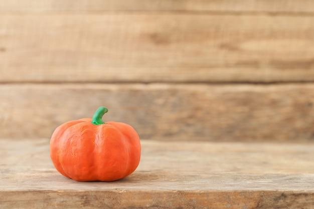 Decorative pumpkin on a wooden background