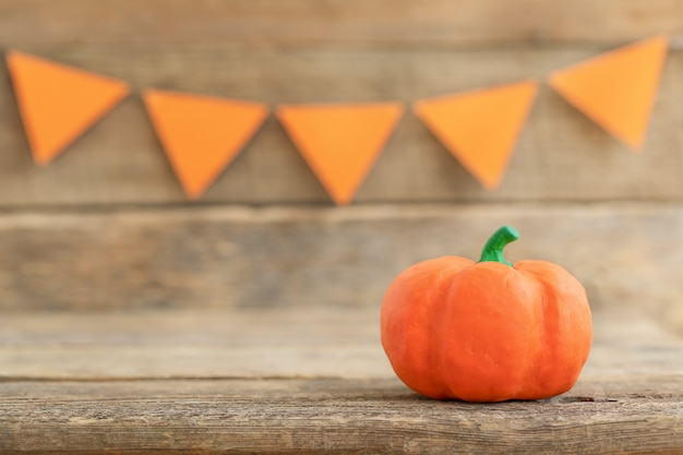 Decorative pumpkin on a wooden holiday background