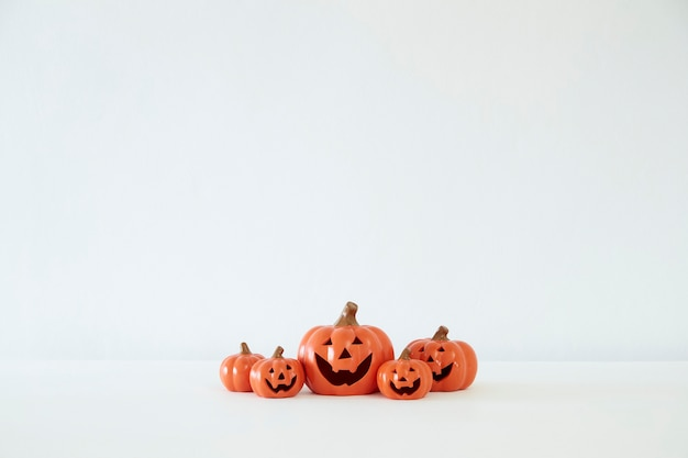 Decorative pumpkins for halloween on white background