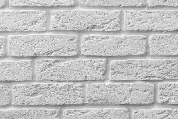 Декоративная грубая белая кирпичная стена фоновой текстуры