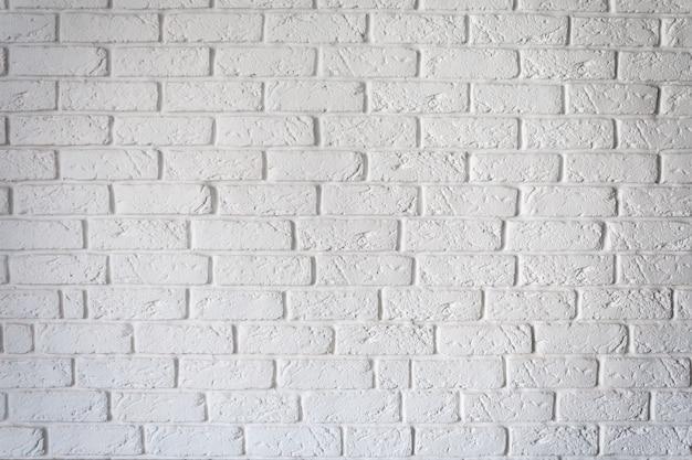 Decorative rough white brick wall background texture