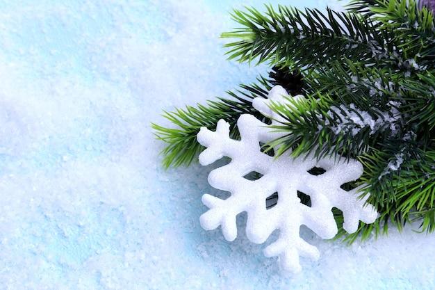 Decorative snowflake and fir tree