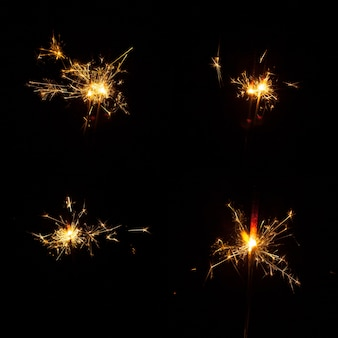 Decorative sparklers on black background
