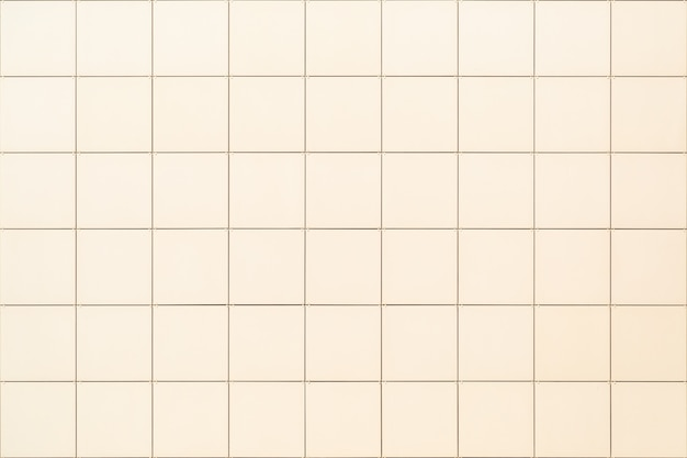 Decorative square beige tile on the facade of the building