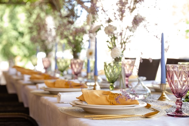 Decorative table setting with beautiful dishes and flowers