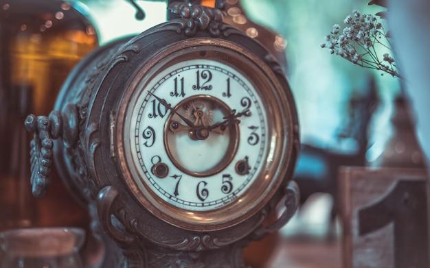 Decorative vintage engraved metal clock