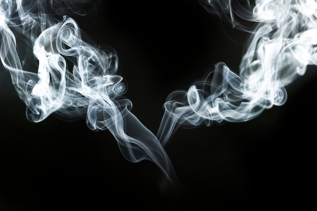 Decorative wavy silhouettes of smoke