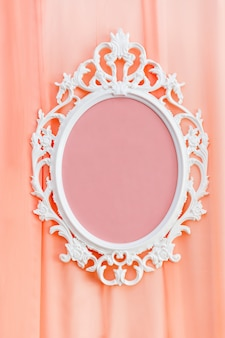 Decorative white frame on coral fabric