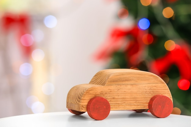 Decorative wooden car on blurred background