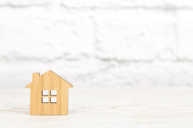 Decorative wooden symbol of a house on white background